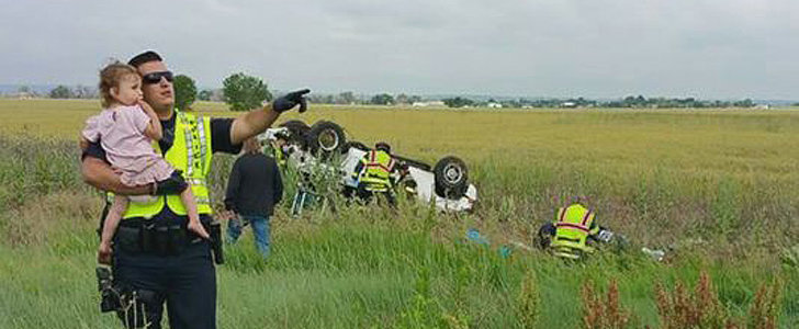 The Heartbreaking Reason This Photo of a Cop Distracting a Girl at a Car Crash Is Going Viral