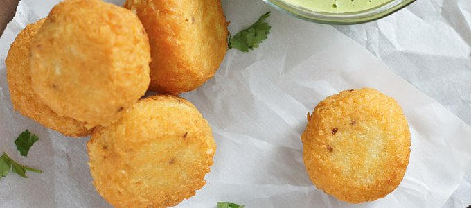 Cheese-Stuffed Yuca Balls With Cilantro Dressing Are Appetizer Perfection