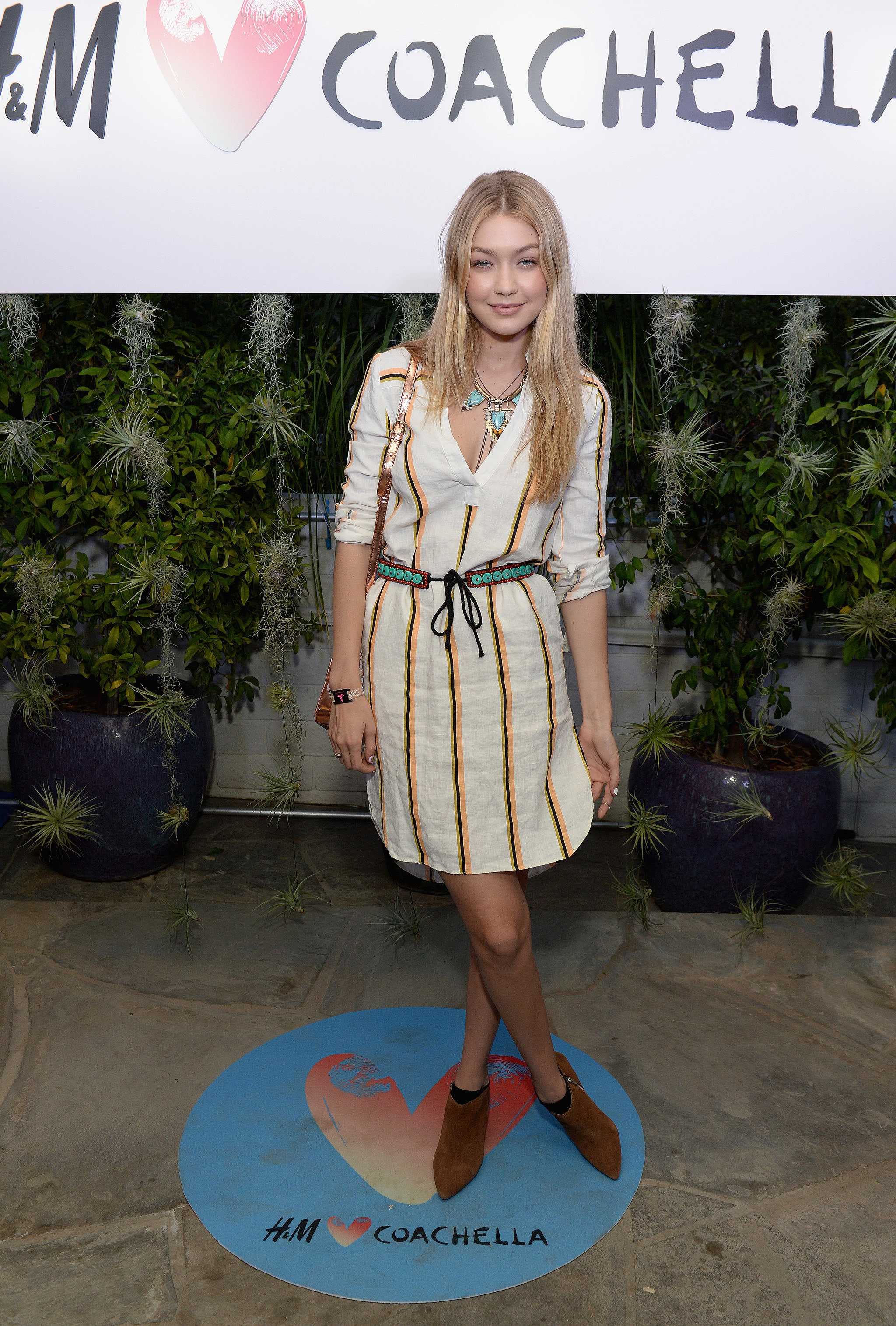 """""""When I first laid eyes on Gigi Hadid at Coachella, I wasn't only into to her lightweight striped dress, but obsessed with the way she styled it. From her black socks that subtly peeked out from beneath brown ankle boots to her statement accessories, complete with pops of turquoise, Gigi looked effortless, but she kept fashion in mind. Her look was movable and breezy enough for a warm Summer day (or night!). It's exactly what I need for the Fourth of July, when my sole plan is to stuff my face with as much BBQ food as I can handle!"""" — Sarah Wasilak, assistant editor"""