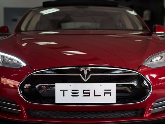 Tesla Hired A Burberry Exec To Rev Up Its Luxury Appeal