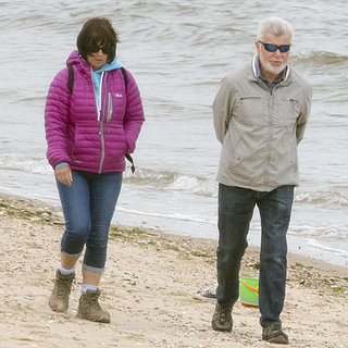 People Walking by Prince George on the Beach