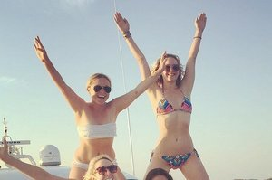 Now Amy Schumer And Jennifer Lawrence Are Doing Human Pyramids On Yachts Together