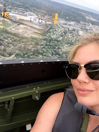 Danger Zone! Kate Upton Takes a Selfie While Flying in WWII Plane