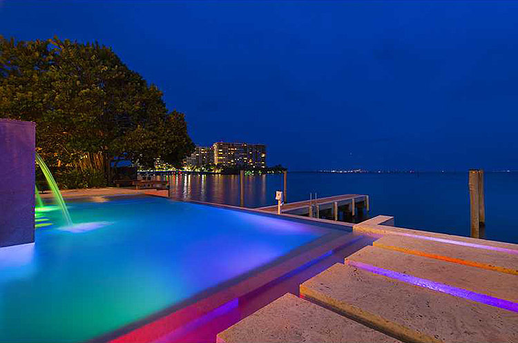 the mansion 39 s infinity pool is embellished with neon. Black Bedroom Furniture Sets. Home Design Ideas