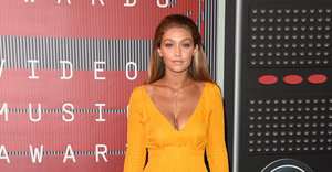 Gigi Hadid Rocks Glorified Yellow Swimsuit At The VMAs