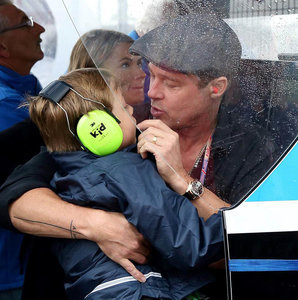 Brad Pitt and son Knox at the MotoGP British Grand Prix in England ahead of Hitting The Apex release