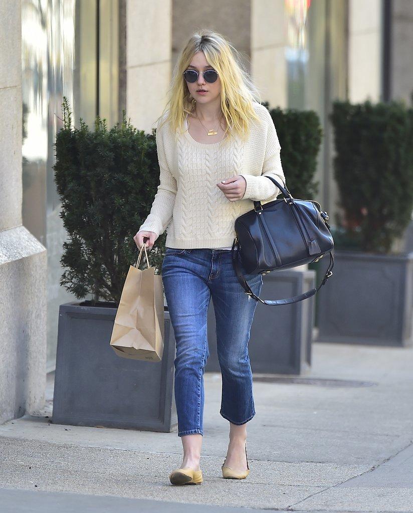 Dakota ran errands in cropped denim, a cream sweater, and a black satchel.