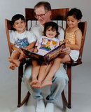 Dad Makes the Most Incredible Chair to Read to 3 Kids at the Same Time