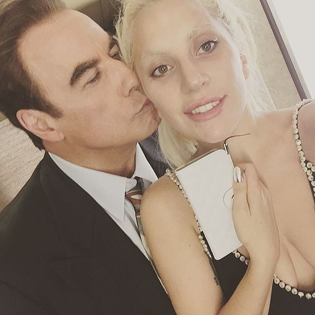 Lady Gaga snapped a photo when John Travolta came to visit her on the set of American Horror Story: Hotel in 2015.