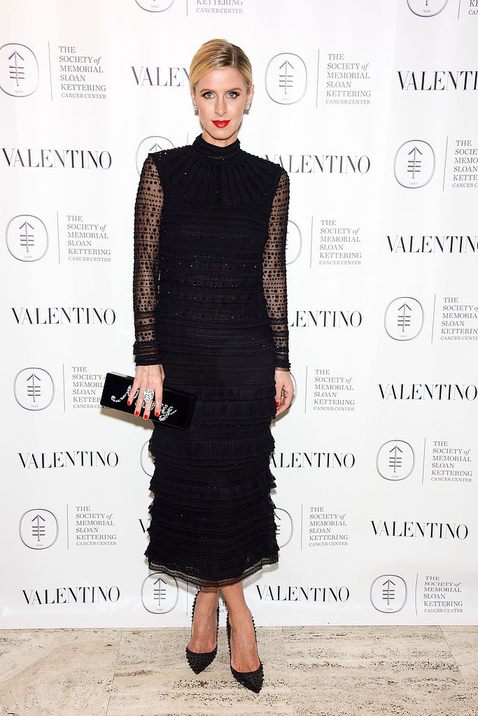 Nicky Hilton in a sheer-sleeved, tiered black dress at the Society of Memorial Sloan Kettering's Fall party.