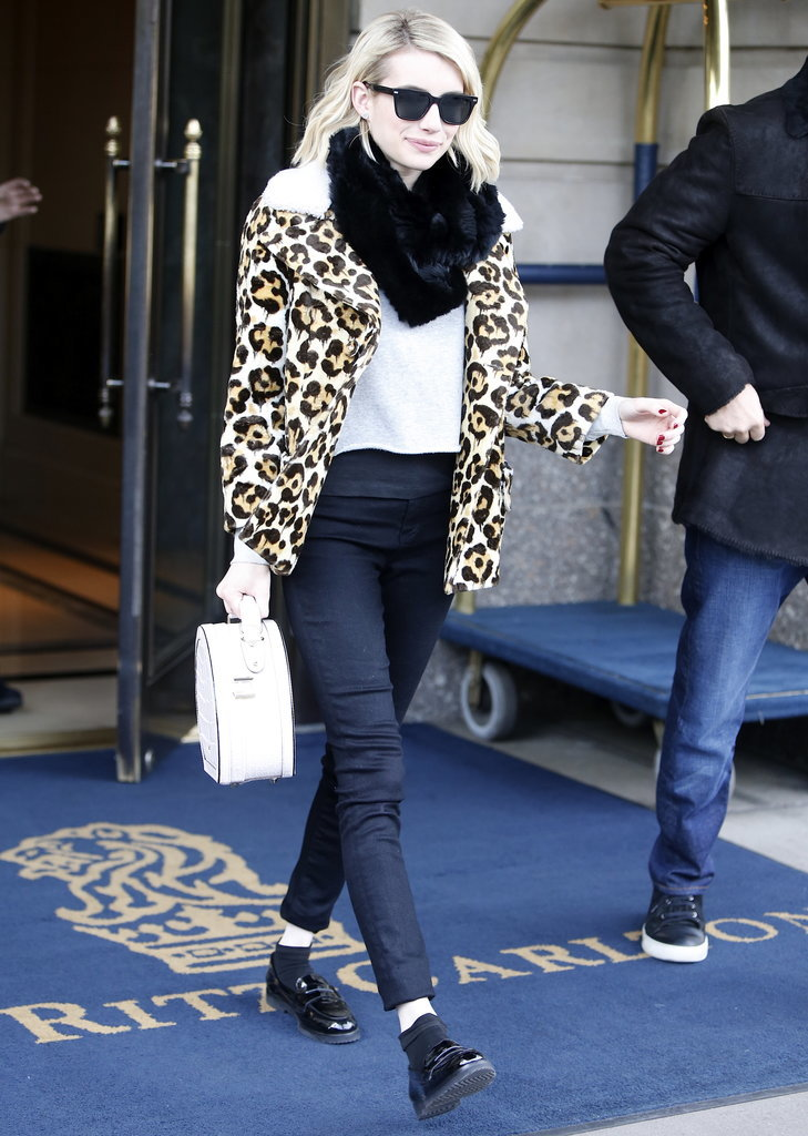 Emma recently paired her favorite leopard coat with a furry scarf, white t-shirt, and loafers.