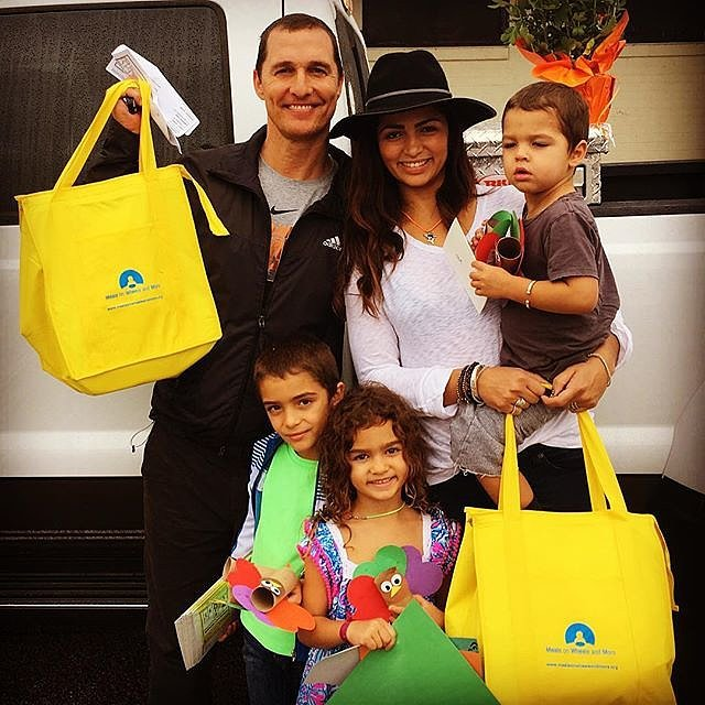 Matthew McConaughey and his wife, Camila Alves, delivered meals on wheels with their children.