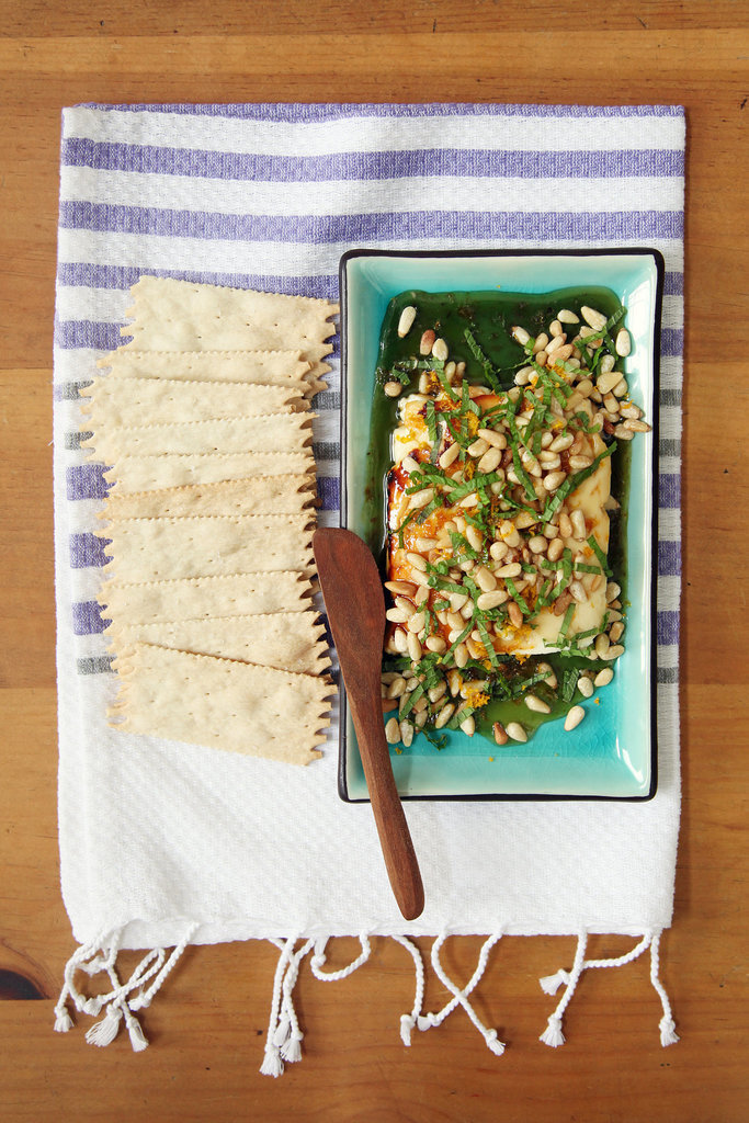 Warn Honey-Drizzled Feta With Pine Nuts, Orange Zest, and Mint