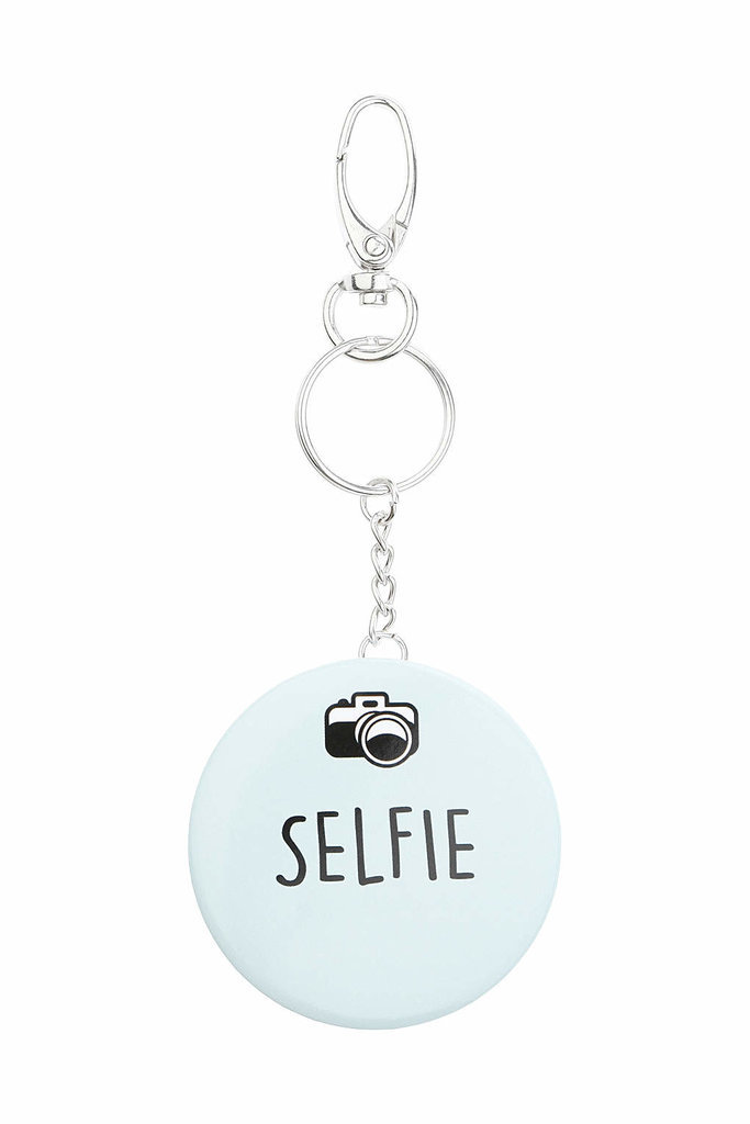 "Since there's no one else you'd rather take a selfie with, gift her this ""selfie"" keychain ($9), so she thinks of you every time she sees it."