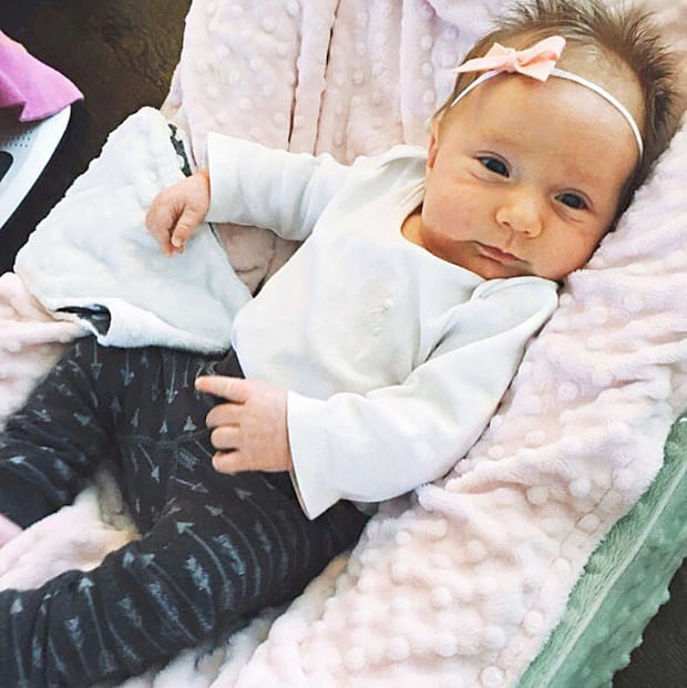 """""""Here is my little angel, Saylor. I couldn't have asked for a better baby. We're very lucky to have such a sweet, easy girl, especially since she's the third one! I guess there was no other option! Happy new year, everyone!"""""""