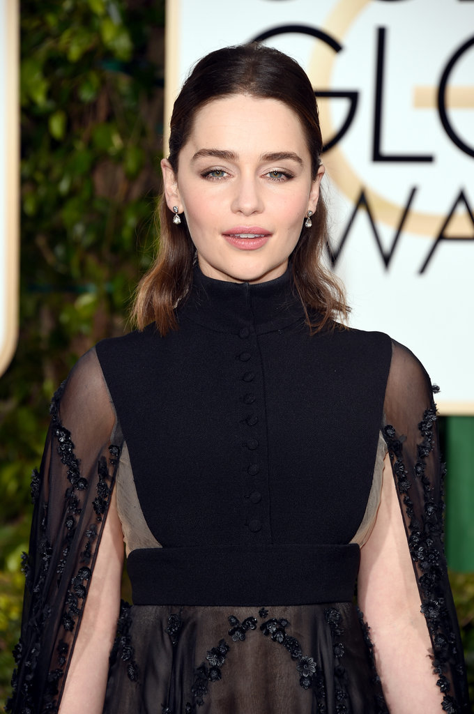As for earrings, Emilia kept it simple, wearing a small drop pair that went perfectly with her gown.