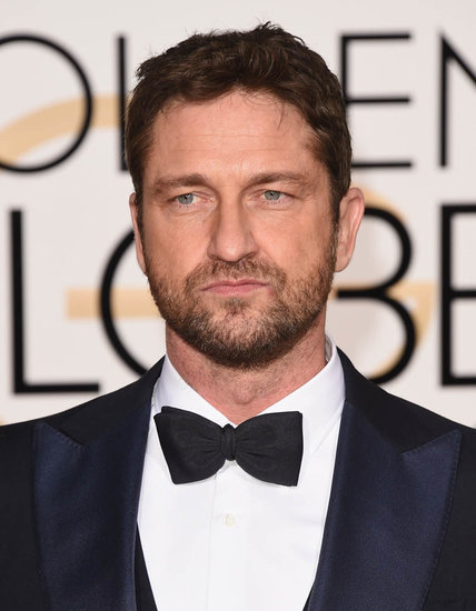 Helen Mirren presents with Gerard Butler at the 2016 Golden Globes