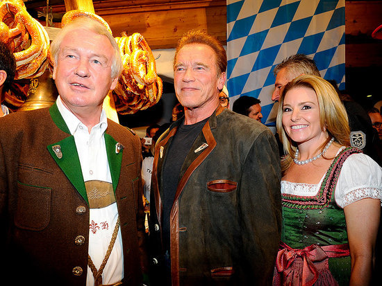 I'll Be Back: Arnold Schwarzenegger Wears a Traditional Outfit and Snacks on Pretzels During Trip Back Home to Austria with Girl