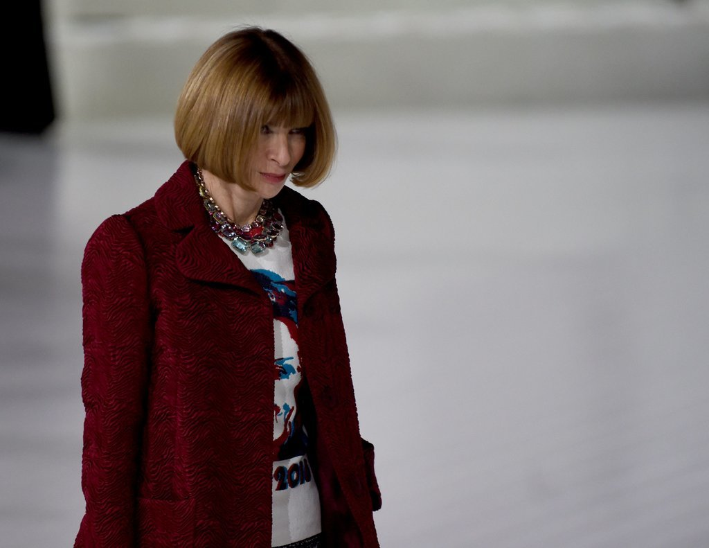 Anna Wintour covered her Hillary shirt in a crisp red coat.