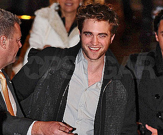 Slide Photo of Robert Pattinson Smiling at Crowd in Paris, France
