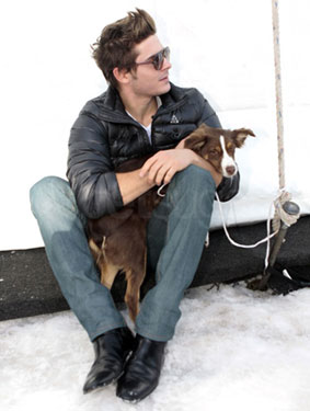 Photos of Zac Efron Playing With Dogs in the Snow in Colorado