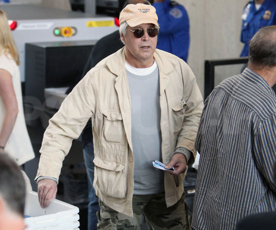 Slide Photo of Chevy Chase Going Through Security at LAX