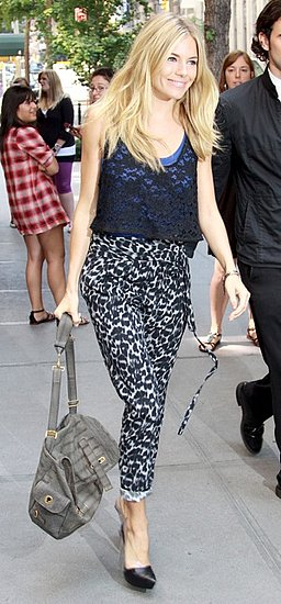 Actress Sienna Miller on Streets of New York in Leopard Print Pants and Cropped Lace Tank