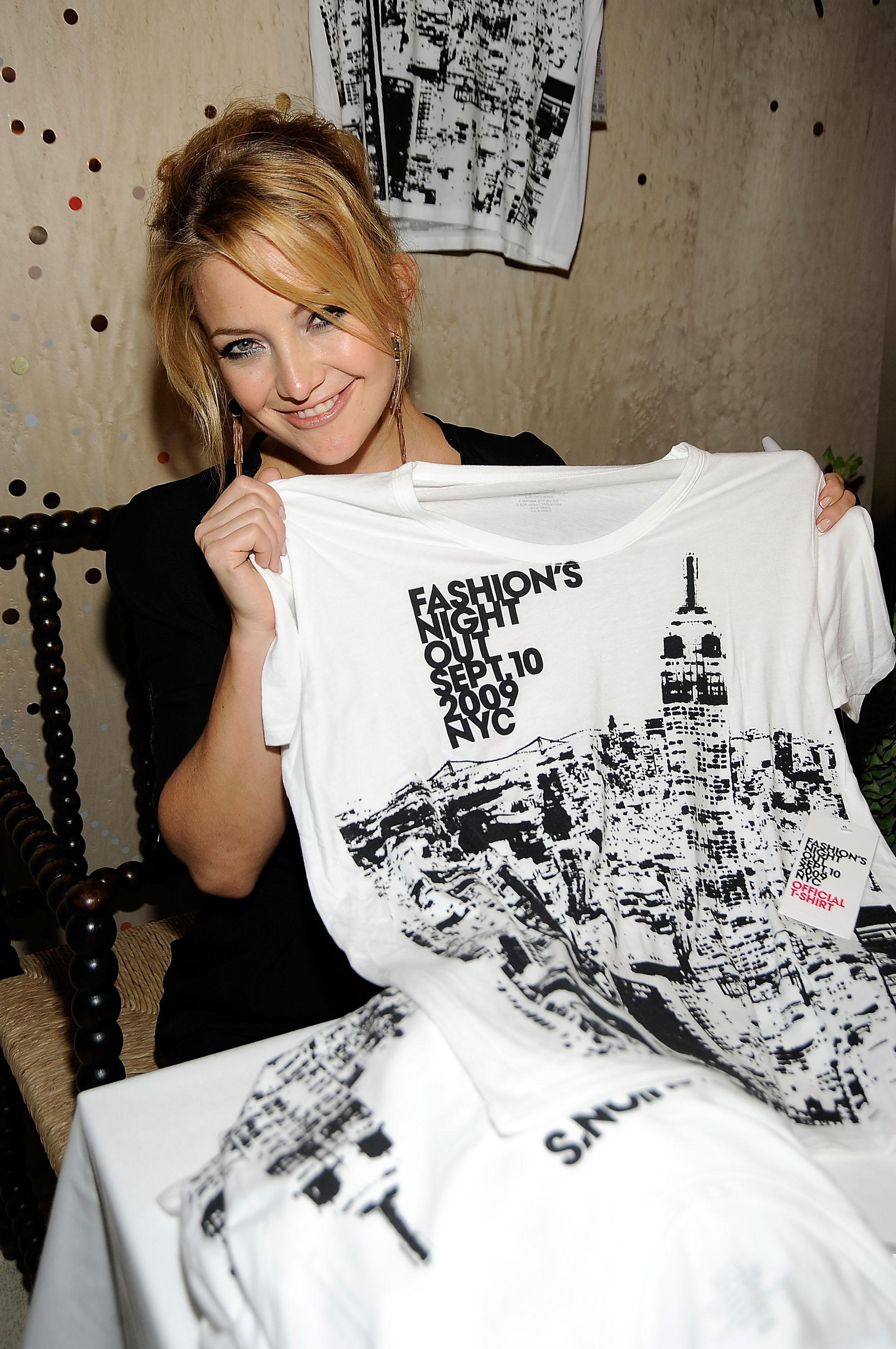 Kate shows off the event's tee