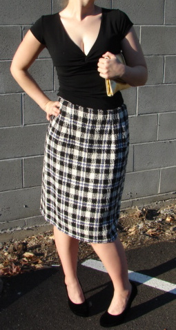 Paid pencil skirt, and gold clutch.