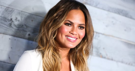 Chrissy Teigen Shows Off Baby Bump In Cute Crop Top