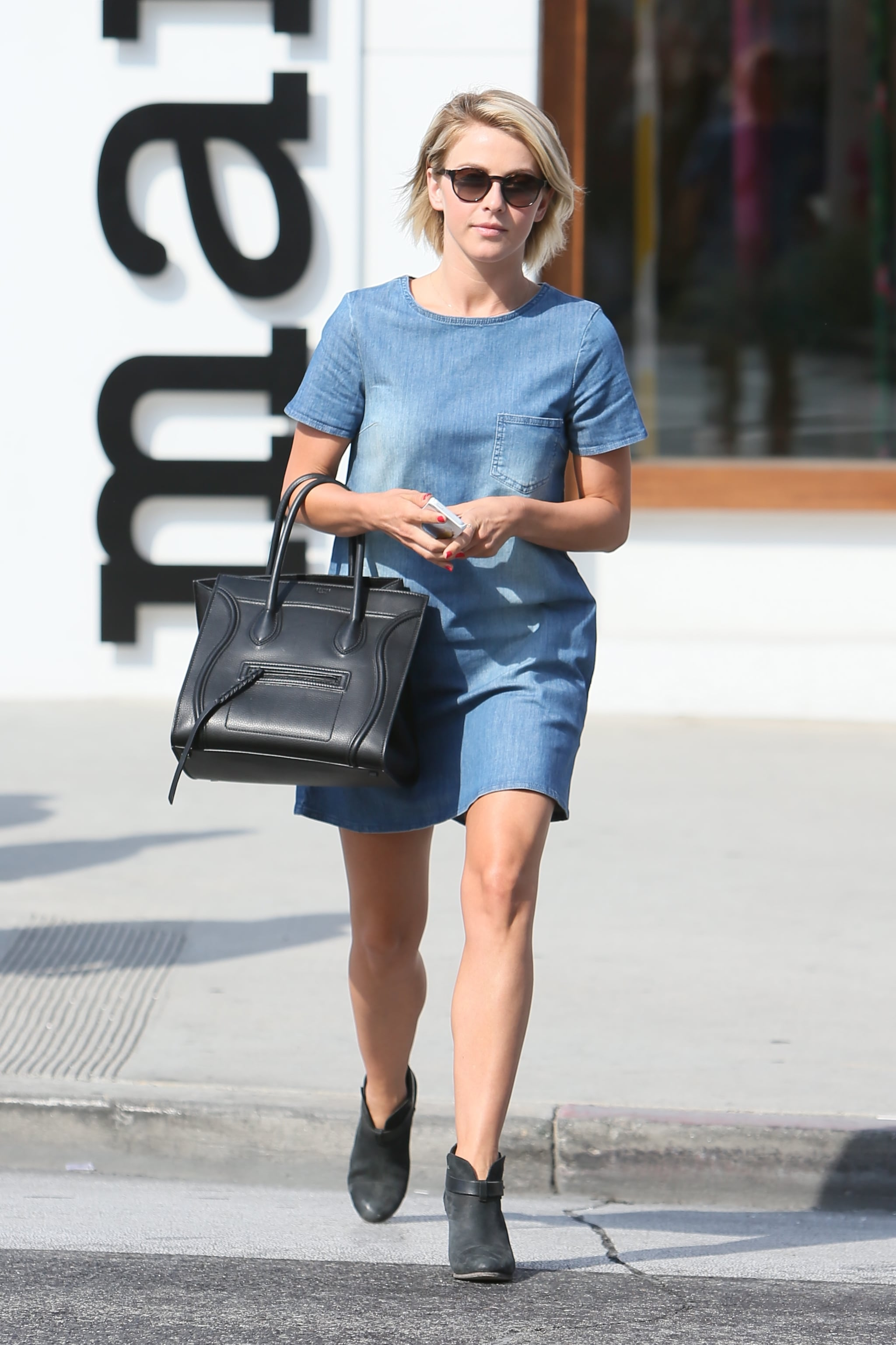 Julianne Hough's little denim dress feels Fall-ready with ankle boots and even tights when the weather calls for it (and you know it will!).