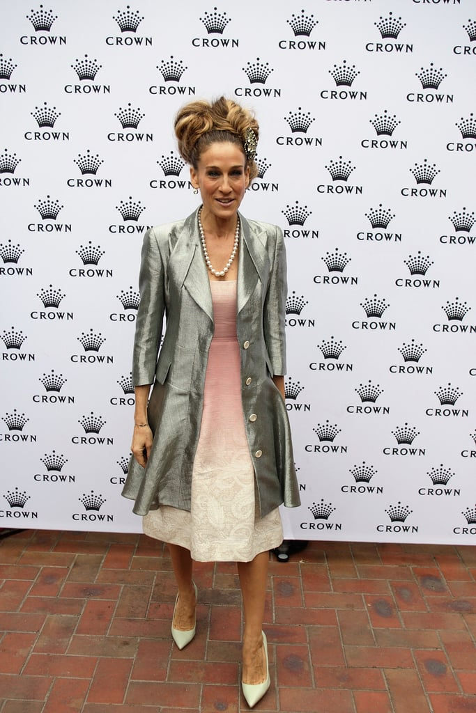 SJP celebrated Crown Oaks Day in a pink ombré Jonathan Saunders creation with a satin iridescent coat and intricate updo, complete with one of her signature brooches, at Flemington Racecourse in Melbourne, Australia.