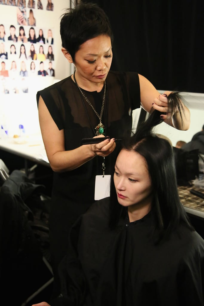 """Jeanie Syfu for Tresemme created the simple, sleek hair. """"It's all about a good blowout,"""" she said. She started off with the brand's Thermal Creations Volumizing Mousse and Keratin Smooth Heat Protection Shine Spray to protect the hair from heat styling. Once the hair was blown out, she sprayed on 24-Hour Body Finishing Spray before going through the hair with a flat iron to make the models' strands completely smooth and straight. She also added extensions underneath the models' own layers, so she could give them all a blunt cut to add to the structured feeling. """"This way it looks really edgy, not retro,"""" she said."""