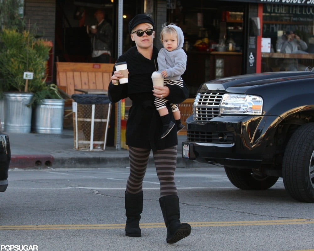 Pink crossed the street with Willow Hart in her arms.