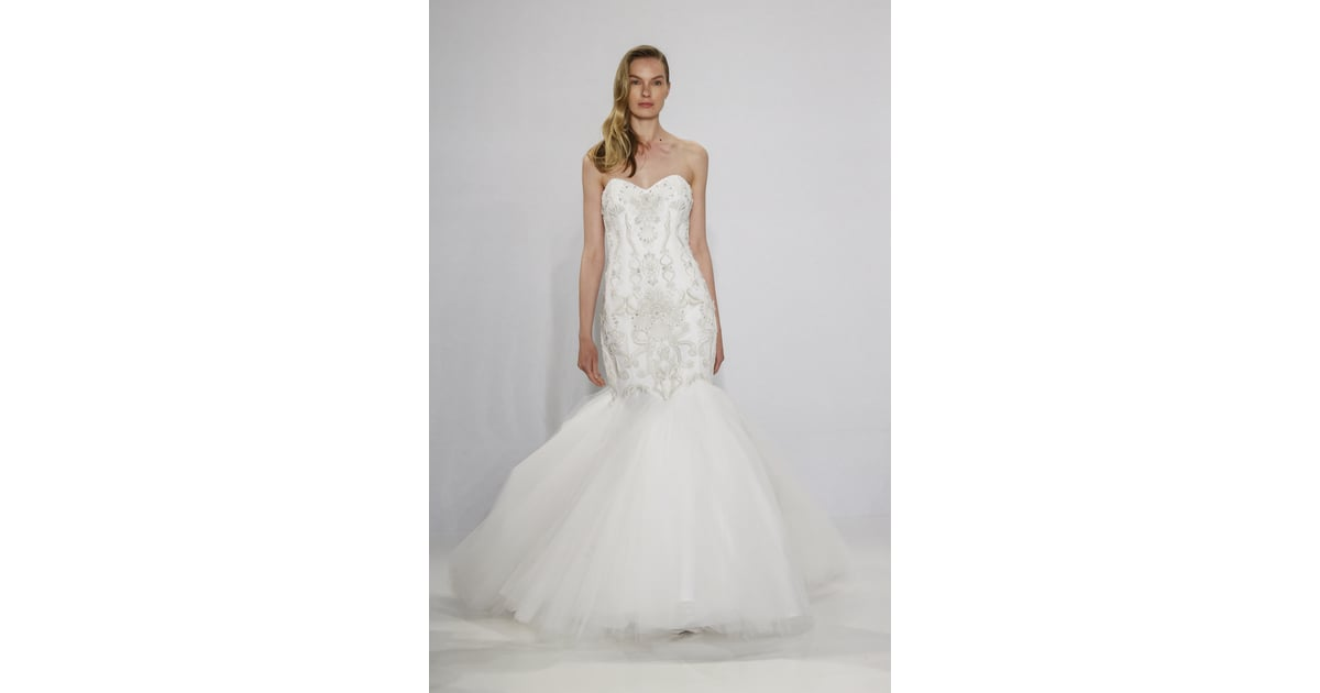Strapless Mermaid Wedding Gown: Embroidered Strapless Mermaid Gown.