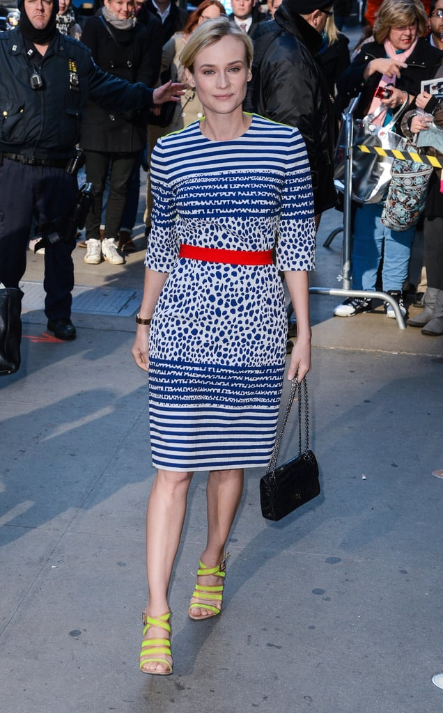 To get Diane Kruger's dainty style, add a bright red belt to a navy and white dress, then for an unexpected finish, neon yellow sandals.