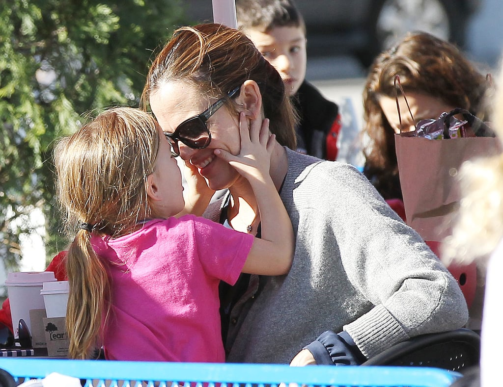 Seraphina squeezed her mom's cheeks.
