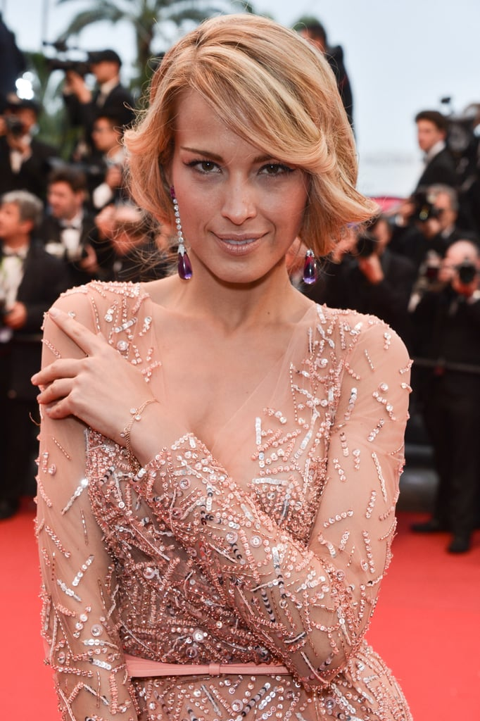 At the All Is Lost premiere, Petra Nemcova wore her long hair in a faux bob to show off her amethyst drop earrings.