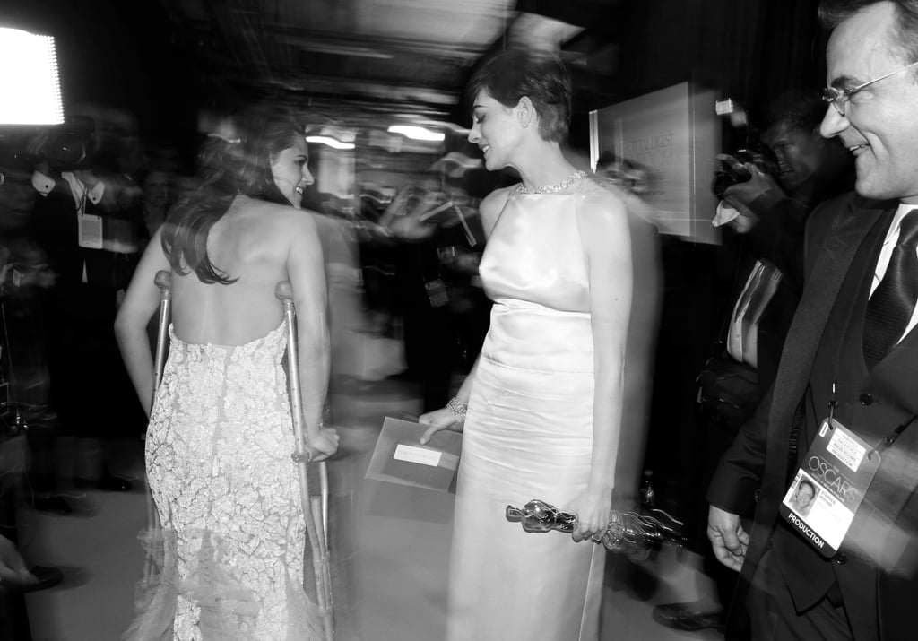 Anne Hathaway and Kristen Stewart backstage at the 2013 Oscars.