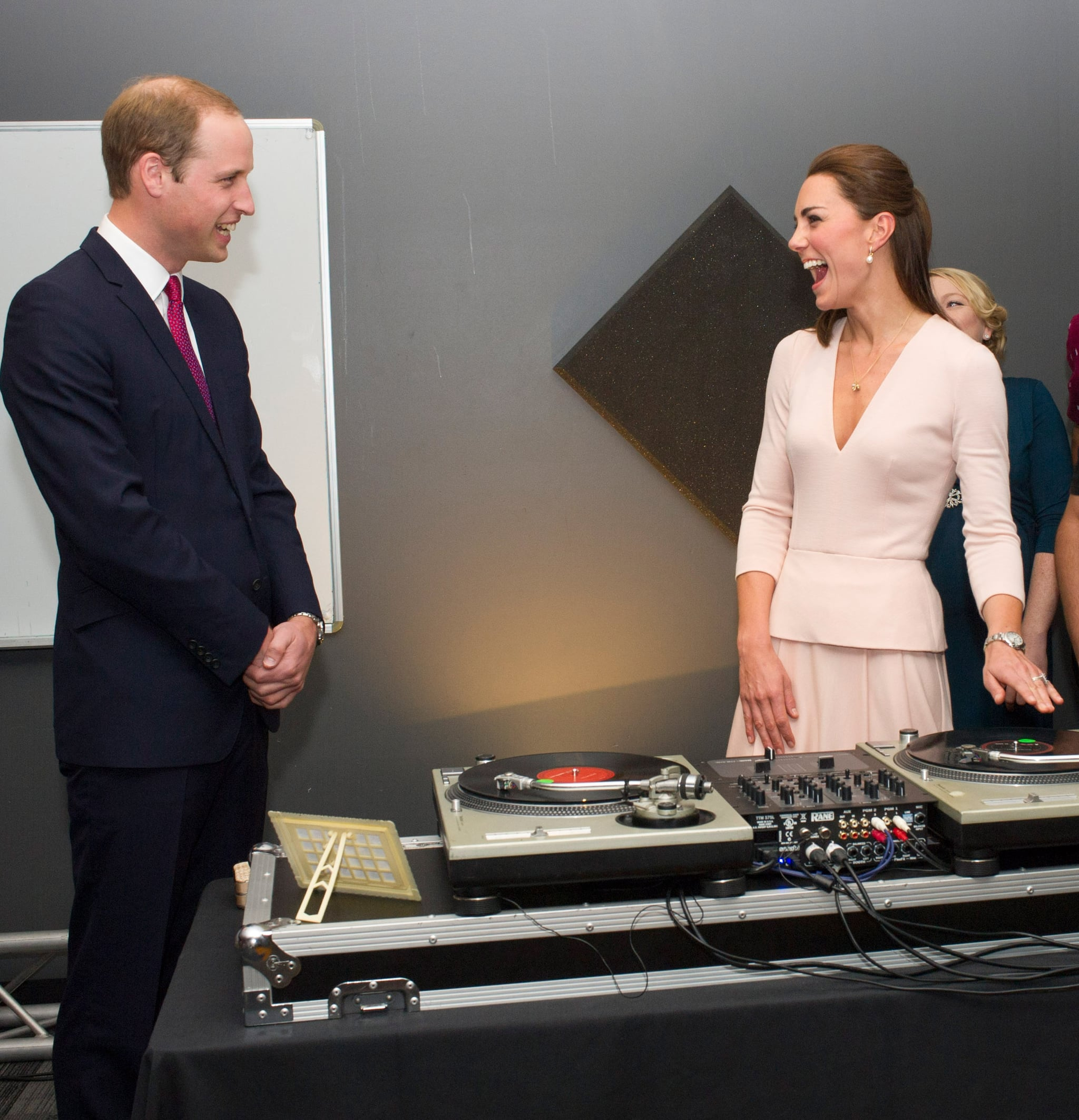 Kate Middleton cracked up while channeling her inner DJ in front of Prince William in Adelaide, Australia during their April 2014 royal tour.