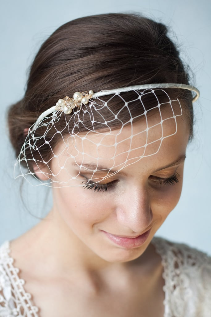 A bridal ivory birdcage veil headband ($55) is simple and sweet, and makes the loveliest accent for the minimalist bride.