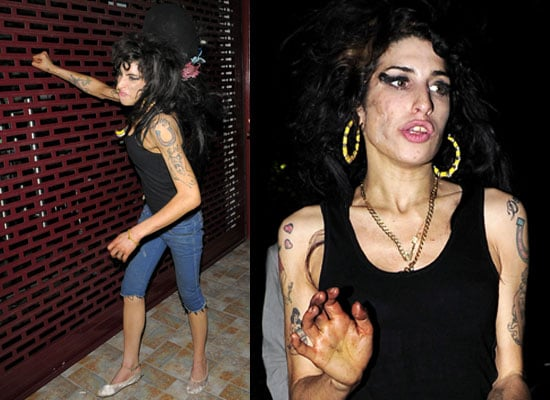 Photos Of Amy Winehouse Punching A Grill