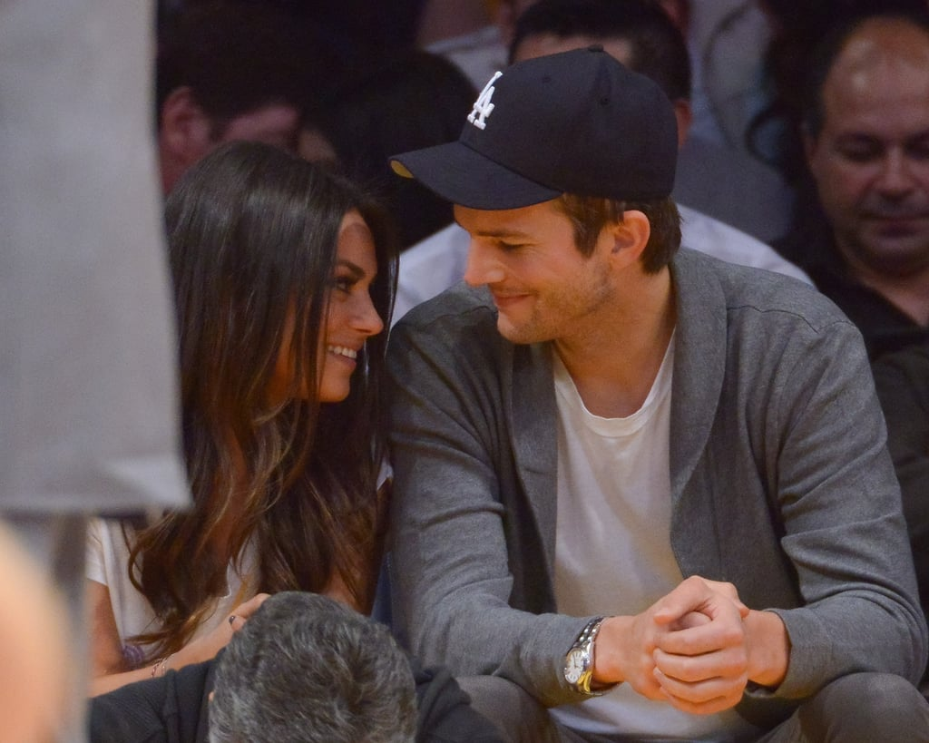 Mila Kunis and Ashton Kutcher stayed close at the Lakers game in LA.