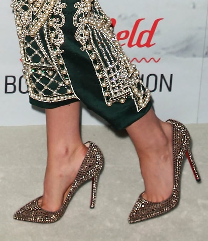A closer look at Kristen's gilded gold Christian Louboutin pumps.