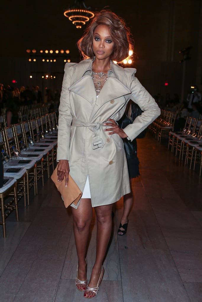 Tyra Banks made an appearance in a slick trench at Marchesa's Spring show.