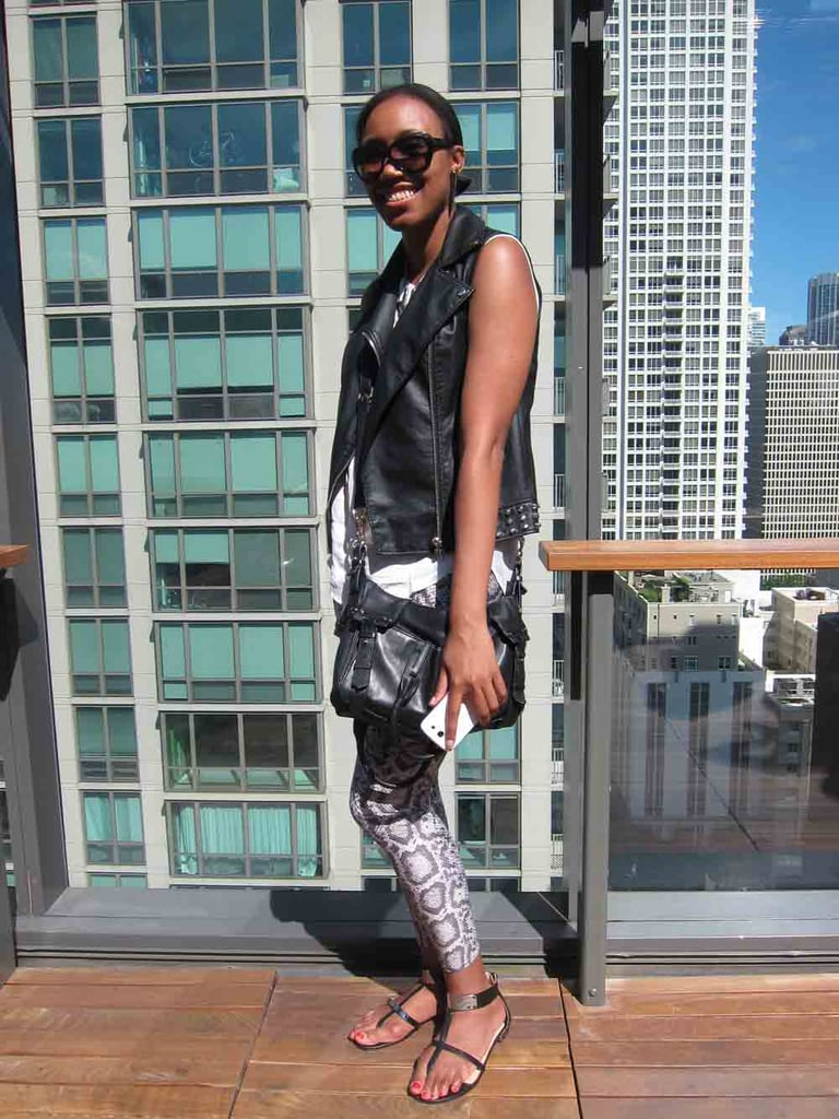 Taneisha channeled a cool-girl biker chic at the MAC Lollapalooza party. Along with a Forever 21 sleeveless moto vest and snakeskin leggings, she kept things cool with a Vince Camuto bag and Prabal Gurung for Target sandals.
