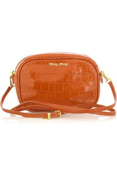 <b>Something Orange</b>. Miu Miu Stamped Leather Clutch $420 @ Net-a-Porter