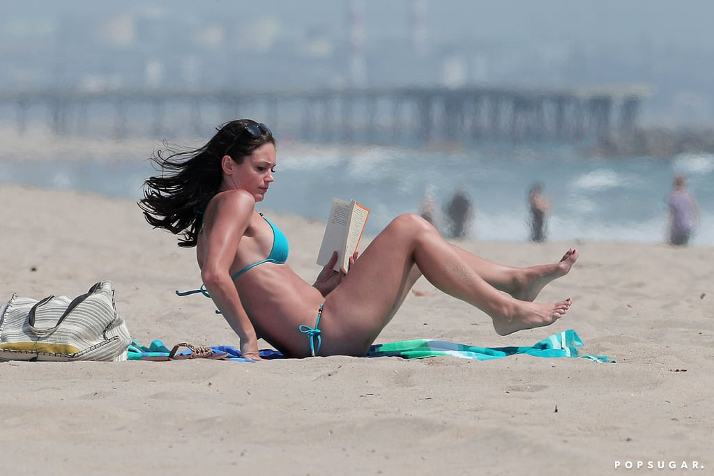 Desiree Hartsock read Little Bee on the beach.