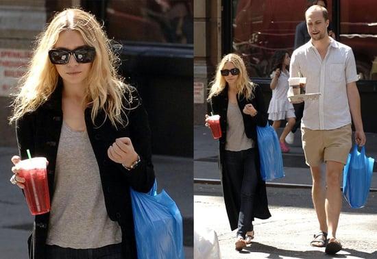 Ashley Olsen in long black coat in the streets of New York