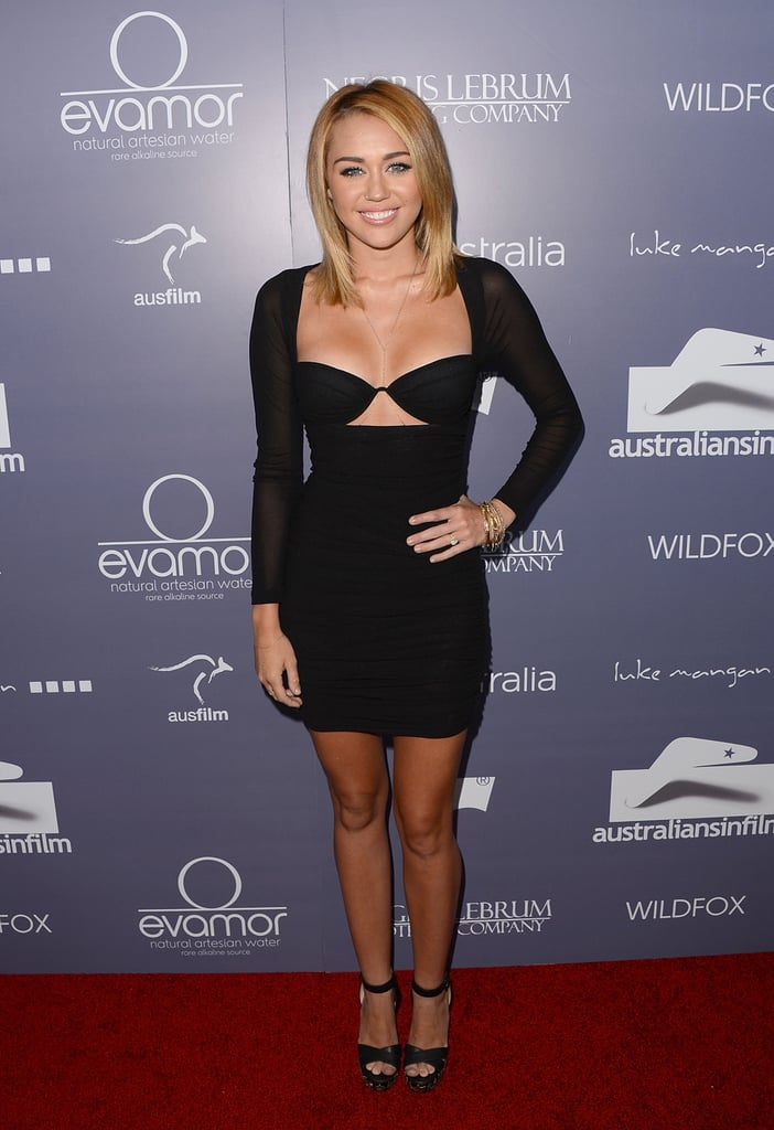 Miley's black cutout Zimmermann dress was likely the talk of the June 2012 Australians in Film Awards — she paired her mini with Christian Louboutin ankle-strap heels and showed off her sparkling engagement ring as she hit the red carpet with fiancé Liam Hemsworth.